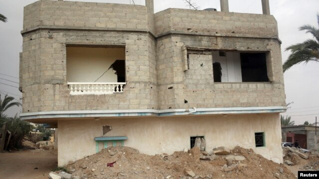 A broken and deserted house, which has a tunnel running underground, is seen in the Egyptian border city of Rafah, May 13, 2013. The house was destroyed due to the construction of the tunnel used for smuggling things from Egypt into Gaza.