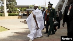 Gambia's President Yahya Jammeh arrives to the opening of the 48th ordinary session of ECOWAS Authority of Head of States and Government in Abuja, Nigeria, Dec. 16, 2015. Gambia ordered female government employees to wear headscarves at work on Jan. 5, 2016, one month after President Yahya Jammeh declared it an Islamic republic.