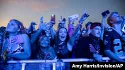 FILE - Festival-goers attend the Voodoo Music Experience in City Park in New Orleans, Oct. 27, 2019. Major concert promoters in the U.S. are stepping back from plans to scan festival-goers with facial recognition technology, at least for the time being.