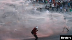 Riot police use a water cannon to disperse anti-government protesters at Taksim Square in central Istanbul, June 15, 2013.