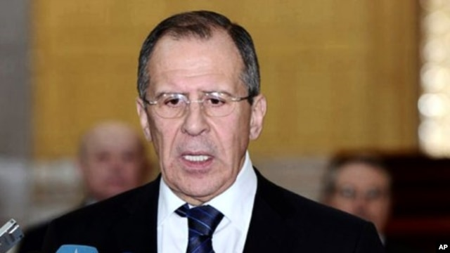 In this photo released by the Syrian official news agency SANA, Russian Foreign Minister Sergey Lavrov, speaks to reporters after his meeting with Syrian President Bashar Assad, at the presidential palace, in Damascus, Syria, February 7, 2012.