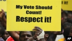 A Zimbabwe human rights activist marches in Harare on World Human Rights Day, Friday, December, 10, 2010. (AP Photo/Tsvangirayi Mukwazhi)