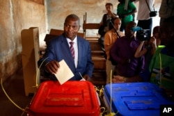 Former Prime Minister Faustin Archange Touadera casts his ballot in the second round of presidential election and the first round of legislative elections in Bangui, Central African Republic, Feb. 14, 2016.