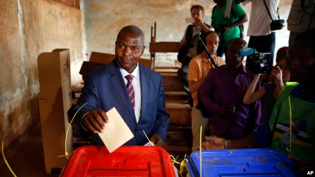 FILE - Former Prime Minister Faustin Archange Touadera casts his ballot in the second round of presidential election and the first round of legislative elections in Bangui, Central African Republic, Feb. 14, 2016. Touadera was declared winner of the election Feb. 20.