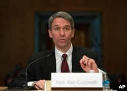 FILE - Former Virginia Attorney General Ken Cuccinelli testifies on Capitol Hill in Washington, Jan. 20, 2016, before a Senate subcommittee hearing on gun control proposals.