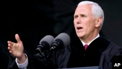 FILE - Vice President Michael Pence speaks at the commencement ceremony at Grove City College, May 20, 2017, in Grove City, Pennsylvania. On Saturday, Pence spoke at the University of Notre Dame in Indiana, where dozens of students staged a walk-out during his address.