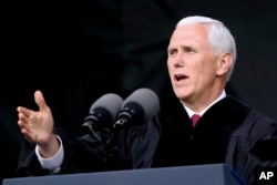 FILE - Vice President Michael Pence speaks at the commencement ceremony at Grove City College, May 20, 2017, in Grove City, Pennsylvania.