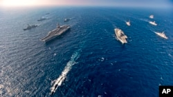 Aircraft carriers and warships participate in the second phase of Malabar naval exercise, a joint exercise comprising of India, US, Japan and Australia, in the Northern Arabian Sea on Tuesday, Nov. 17, 2020.