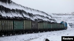 FILE - A train transports coal the Borodinsky opencast colliery, near the Siberian town of Borodino, some 152 km (94 miles) east of Krasnoyarsk, Nov. 15, 2012.