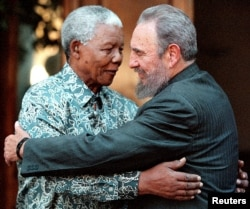 FILE - Former South African President Nelson Mandela (L) hugs Cuba's President Fidel Castro during a visit to Mandela's home in Houghton, Johannesburg, Sept. 2, 2001.