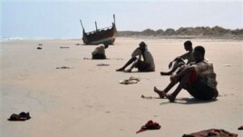 In this image released by UNHCR, unidentified refugees rest on an undisclosed beach in Yemen in March 2007. Many Ethiopians and Somalis hire smugglers to get them to Yemen. However, many are robbed, abused and some even thrown overboard.