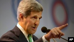 FILE - United States Secretary of State John Kerry delivers a speech at the U.N. Climate Change Conference in Lima, Peru.