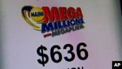A sign advertises the value of the Mega Millions lottery at a convenience store in Lisbon, Maine, Dec. 17, 2013.