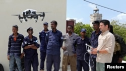 FILE - Somali police officers watch a drone demonstration in May 25, 2017. (REUTERS/Feisal Omar)