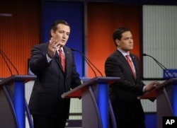 FILE - Ted Cruz speaks as Marco Rubio listen during a Republican presidential primary debate.