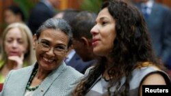 Socorro Hernandez (left) and Tania D' Amelio talk during their swearing in ceremony as new board members of the National Electoral Council, at the Supreme Court in Caracas, Venezuela, Dec. 14, 2016.