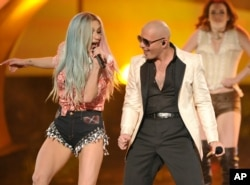 Ke$ha, left, and Pitbull perform on stage at the American Music Awards at the Nokia Theatre L.A. Live on Nov. 24, 2013, in Los Angeles.