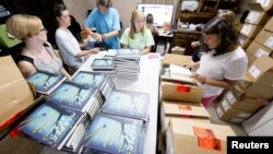"""Employees unbox """"Go Set A Watchman"""" at Ol' Curiosities & Book Shoppe in Monroeville, Alabama July 14, 2015."""