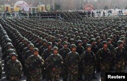 Paramilitary policemen stand in formation as they take part in an anti-terrorism oath-taking rally, in Kashgar, Xinjiang Uighur Autonomous Region, China, Feb. 27, 2017.