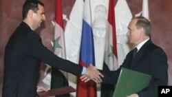 阿萨德总与普京总统握手言欢,资料照片
