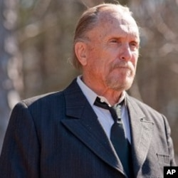 Robert Duvall as Felix Bush