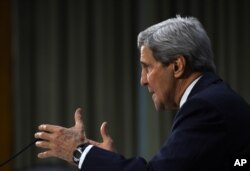 """Secretary of State John Kerry testifies on Capitol Hill in Washington, Dec. 9, 2014, before the Senate Foreign Relations hearing on """"Authorization for the Use of Military Force Against IS."""""""