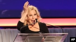 FILE - Bette Midler speaks at 15th Annual Movies for Grownups Awards at the Beverly Wilshire Hotel, Feb. 8, 2016, in Beverly Hills, California. Along with Cate Blanchett and Sally Field, Midler received a best actress nomination in Broadway's Tony Awards Tuesday.