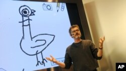 "FILE - Children's author and illustrator Mo Willems shows audience members how to illustrate their own Pigeon stories in his first-ever app ""Don't Let the Pigeon Run This App!"" at an Apple store in New York, Oct. 29, 2011."