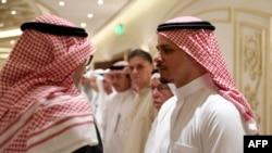 Salah Khashoggi, right, the son of murdered Saudi journalist Jamal Khashoggi, and his relatives receive mourners at an events hall in the Saudi coastal city of Jeddah, Nov. 16, 2018.