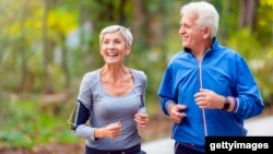 An older couple couple jogging in the park. (Getty Images)