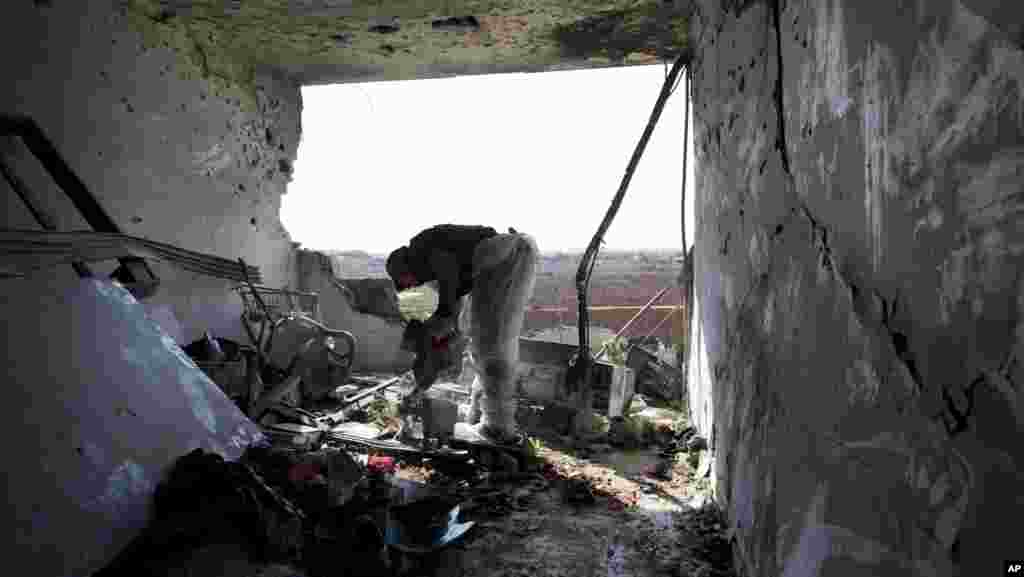 A Zaka volunteer cleans blood stains from an apartment in a building that was hit by a rocket fired from the Gaza Strip, where three people were killed in Kiryat Malachi, southern Israel, Kiryat Malachi, southern Israel, November 15, 2012.