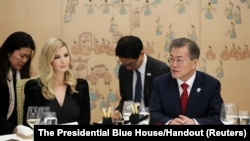 South Korean President Moon Jae-In talks with Ivanka Trump during their dinner at the Presidential Blue House in Seoul, South Korea, Feb. 23, 2018.