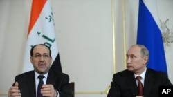 Tổng thống Nga Vladimir Putin (phải) và Thủ tướng Iraq Nouri al-Maliki tại cuộc họp báo ở Moscow ngày 10/10/2012.