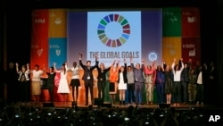 Speakers at the opening ceremony celebrate the adoption of the new Sustainable Development Goals during the 6th Annual Social Good Summit on Sunday, Sept. 27, 2015 in New York. An initiative of United Nations Foundation, Mashable,