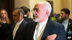Iran's Foreign Minister Mohammad Javad Zarif walks into another negotiating meeting with United States Secretary of State John Kerry over Iran's nuclear program in Lausanne, Switzerland, March 18, 2015.