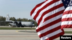 A U.S. Air Force plane is seen at an airport in Riga, Latvia, April 24, 2014.