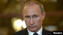 FILE - Russia's President Vladimir Putin talks to reporters.