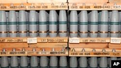 FILE - This Jan. 21, 2010, file photo shows 105mm shells containing mustard agent that are stored in a bunker at the Army's Pueblo Chemical Storage facility in Pueblo, Colo.