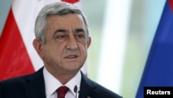 FILE - Armenia's President Serzh Sargsyan speaks during a news briefing in Tbilisi, Georgia, Oct. 30, 2015.