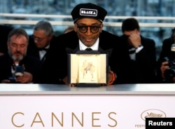"FILE - Spike Lee, director of the film ""BlacKkKlansman,"" poses after the closing ceremony of the 71st Cannes Film Festival, Cannes, France, May 19, 2018."