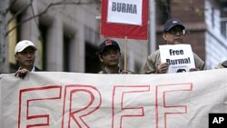 "Activists hold ""Free Burma"" placards at a protest in Sydney in support of marches in Rangoon by Buddhist monks, (File)."