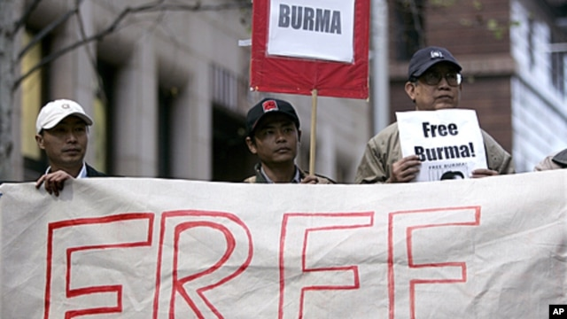 """Activists hold """"Free Burma"""" placards at a protest in Sydney in support of  marches in Rangoon by Buddhist monks, (File)."""