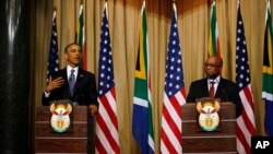 FILE - U.S. President Barack Obama and South African President Jacob Zuma address a press conference following their meeting at Union Building in Pretoria, South Africa, June 29, 2013.