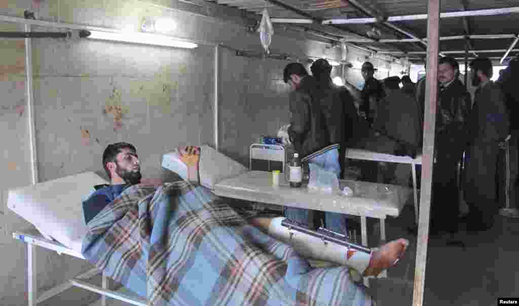 Free Syrian Army fighters, wounded during the battle to capture Taftanaz air base, receive treatment at a field hospital in northern Idlib, Syria, January 6, 2013.