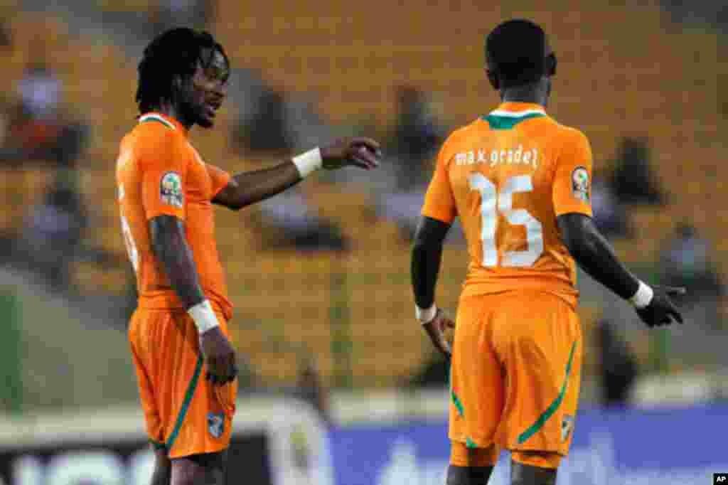 Jean-Jacques gives instructions to Max Alain of Ivory Coast during their African Nations Cup soccer match against Burkina Faso in Malabo