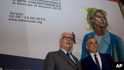 Venice Biennale President Paolo Baratta and Italian Festival Director Alberto Barbera, right, pose prior to a press conference to present the Venice Film Festival, in Rome, July 29, 2015.