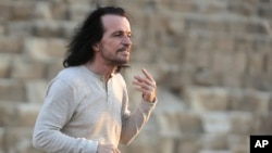 Greek musician Yiannis Hrysomallis, who goes by the stage name Yanni, poses during his visit to the Giza Pyramids, just outside Cairo, Egypt, Oct. 28, 2015.