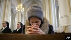 A Russian woman prays inside a Catholic Church in Presnya. (file)