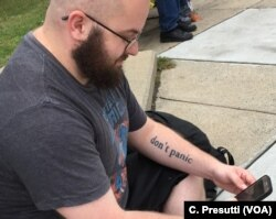 """Matt (no last name given) waits for friends to march to the Boston Common. He's a war veteran and says """"I don't want my country to look like this with so much hate and people who want to kill everyone else."""""""