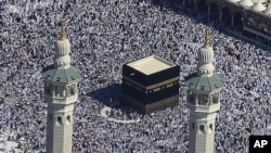 Muslim pilgrims moving around the Kaaba, the black cube seen at center, inside the Grand Mosque, during the annual Hajj in the Saudi holy city of Mecca, Saudi Arabia, November 7, 2011.